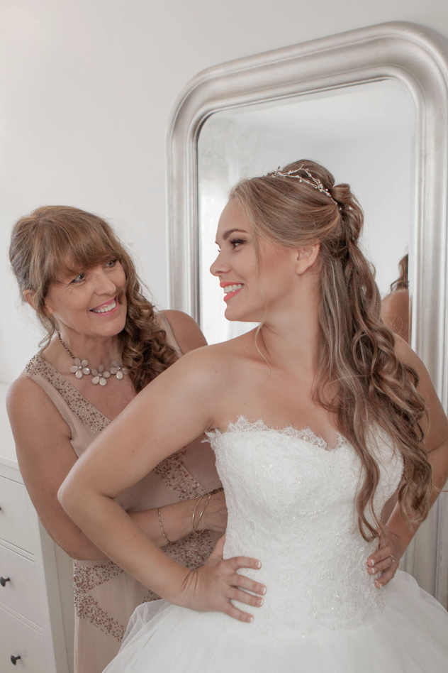 Happy Bride and Mother Dressing on Wedding Day.
